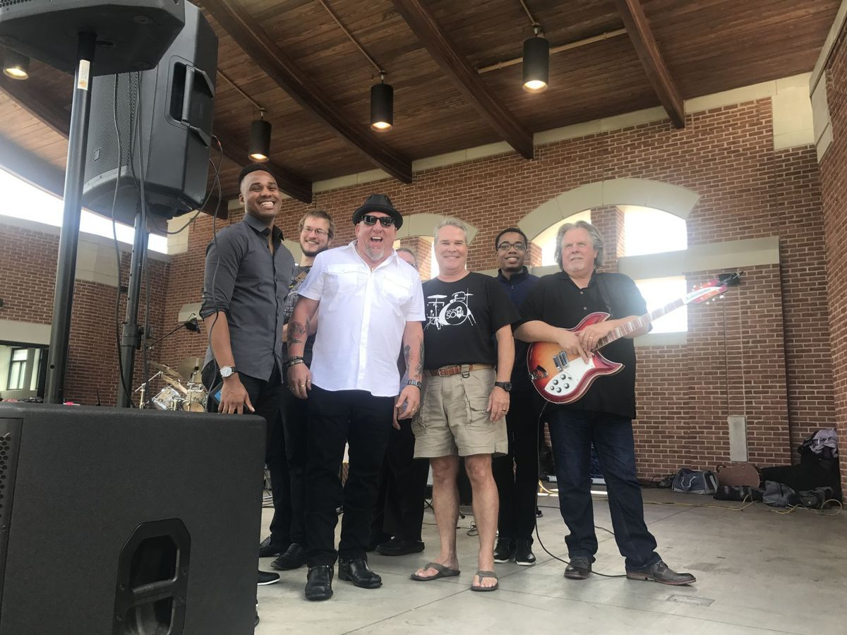 MonoSol CEO P. Scott Bening with the band MonoSoul at the company's annual picnic in downtown Valparaiso.